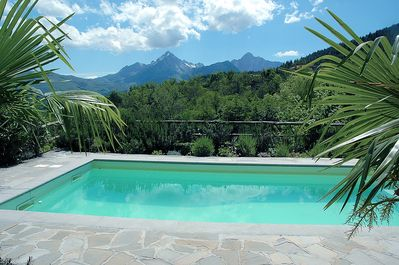 The pool terrace has spectacular views of the wooded hillsides and mountains.