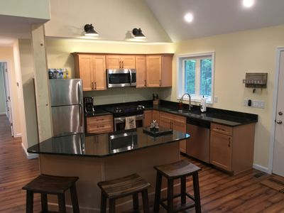 Eat in kitchen, high end appliances and gas range compliment any chef.