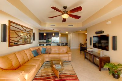 Comfortable living area with HD television (there are three HD TV's in the condo