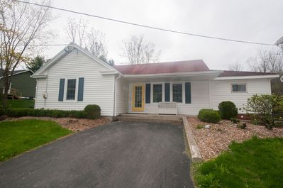Front of house with driveway.