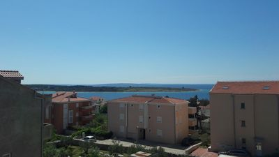 Photo for One bedroom apartment with terrace and sea view Novalja, Pag (A-15719-a)