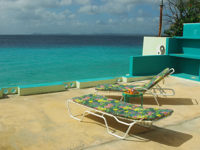 Sun terrace with BBQ area with view on Klein Bonaire in the bay of Kralendijk.