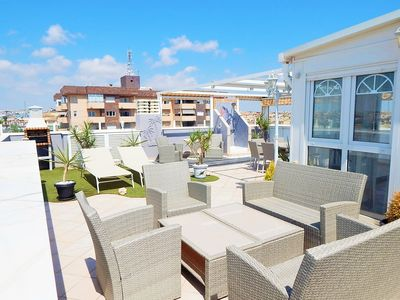 Photo for Unique penthouse with a huge private roof teracce, close to the beach.