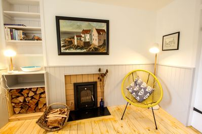 Log burner comes with an ample supply of logs and the fire ready to light