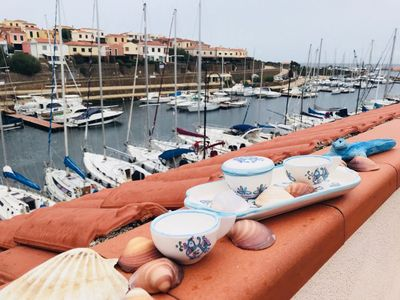Photo for Terrace-barbecue on the port of Stintino, panoramic and central position.