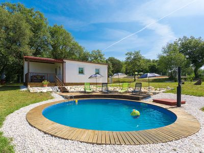 Photo for This 3-bedroom villa for up to 5 guests is located in Porec and has a private swimming pool, air-con