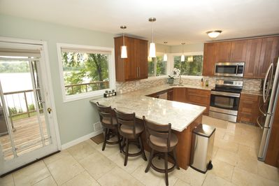 Stainless steel appliances, new cabinets and granite countertops.