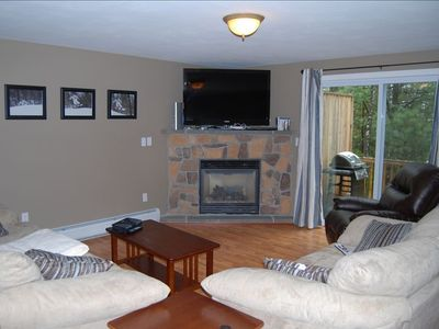 Pullout Couch in Living Room Along with 52 Inch LCD 1080p TV Over Fireplace