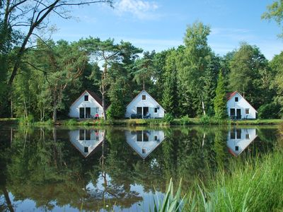 Photo for Detached home in nice holiday park, directly by the fishing pond