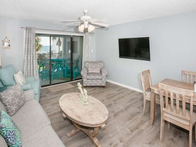Photo for Newly remodeled and beautifully decorated | Steps to the beach, Outdoor pool, BBQ | Free Activities