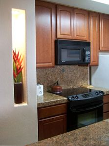 New Kitchen with Granite Counters & designer inlay brass tiles