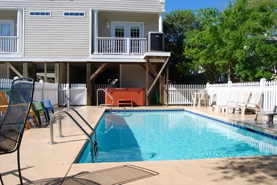Backyard facing home with large 12 x 24 ft pool and hot tub.