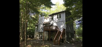 Photo for Beautiful pococno house in mint condition in gated Big Bass lake/weekly summer