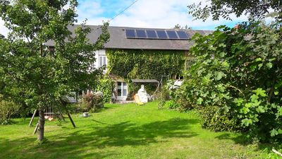 Photo for NORMANDY: Family-friendly apartment Grape with large garden near the sea