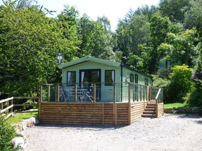 Photo for Secluded caravan in woodland setting. Pet friendly, sleeps 8 guests (unit C12)