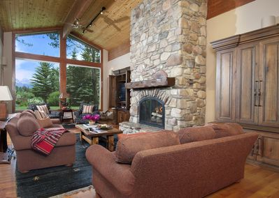 The magnificent stone fireplace in the living room