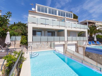 Photo for Aucanada Lighthouse A - Spectacular villa with pool and sea views in Alcanada