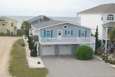 Front of house with ocean in the background