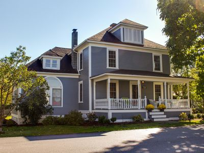 Photo for Charming farmhouse with a porch, covered deck & large  lawn - close to town!