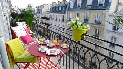 Take in the beautiful Parisian rooftop view at the Saumur apartment