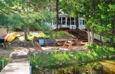 Lakeside view.   The picnic table and fireplace are waiting for your cookout.