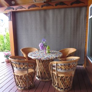 2 BEAUTIFUL TABLES AND CHAIRS OUTSIDE, ONE ON EACH SIDE OF THE DECK &  FLOWERS!