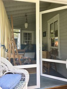 Screened in Side Porch with daybed