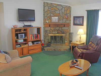 Photo for Centrally located mountain condo w/two porches & wood-burning fireplace
