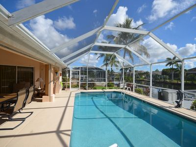 Photo for Heated Pool/Waterfront/Canal/Dock/Gulf Access, Private Sunny Home