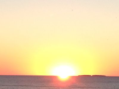 Sun setting behind High Island. View from our front deck.