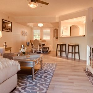 Enormous Great Room Living space with lots of comfortable seating, flat screenTV