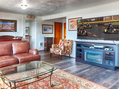 """The main living room of this 7 bedroom house is complete with modest ocean views, 55"""" SmartTV, XBox One and seating for 10"""