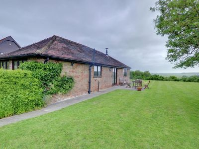 Photo for Comfortable holiday home with high ceilings and open fireplace, set in green surroundings