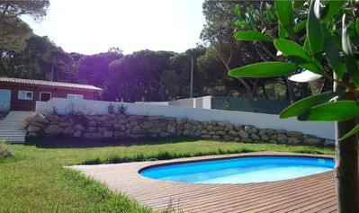 Photo for A beautiful mountain home with private pool, lawn five minutes from the beach,