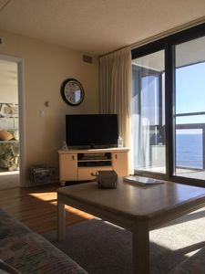 """View of ocean, 51"""" flat screen, cable, VCR, DVD, puzzles/tapes,DVDs in cabinet."""
