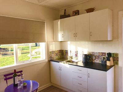 A nice sunny kitchen with everything you need.