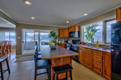 Nice open spacious kitchen with eating bar,  gas range & sensational lake views!