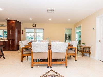Photo for Completely Remodeled 4 Bed Waterfront Getaway! Screened In Covered Patio.
