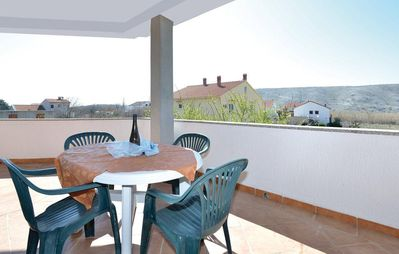 Photo for One bedroom apartment with terrace and sea view Vlašići, Pag (A-12766-a)
