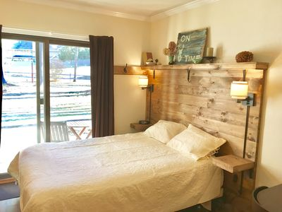 Hand made, rustic headboard sets the tone for the space