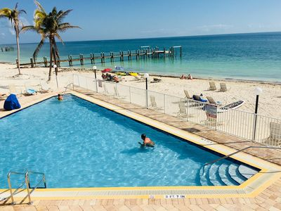 Photo for PS Sandy Beach, Pool View, dock, WiFi, Tennis, Jacuzzi, arrive any day, tropical