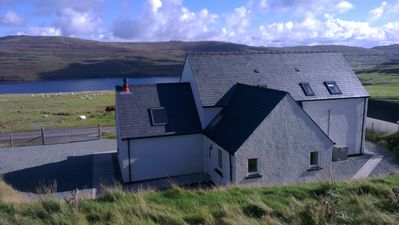 Photo for Lovely cottage with views of loch. Near to Neist Point light house.