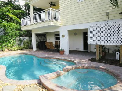 Photo for Luxury waterfront home with a heated pool and spa!