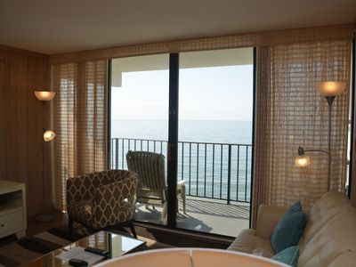 Photo for BRIGHT AND CHEERY TWO BEDROOM OCEAN FRONT CONDO STEPS AWAY FROM THE OCEAN!