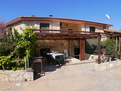 Photo for 300 meters from the beach of S'arena Scoada, 5 beds, 2 bathrooms, BBQ.