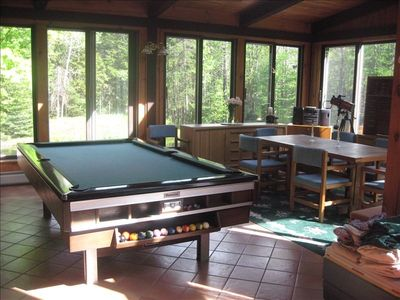 Looking from family room and kitchen...left of pool table is large living room