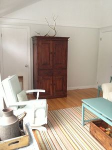 living room - the armoire contains a tv, board games, and puzzles