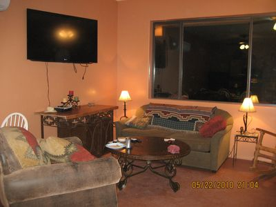 Living room which has an incredible view of red rocks and a pull out couch