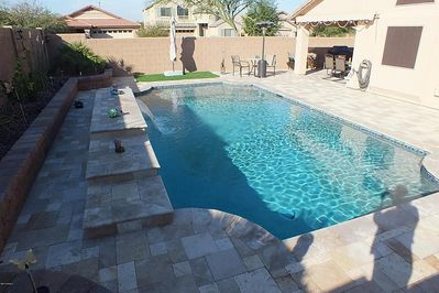Swimming pool/deck area.  Note: Artificial turf patch w/ large umbrella.