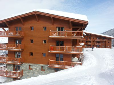 Photo for ARC 1800 LE ROSELEND Luminous apartment Skis with feet Swimming pool 3 ch 6P